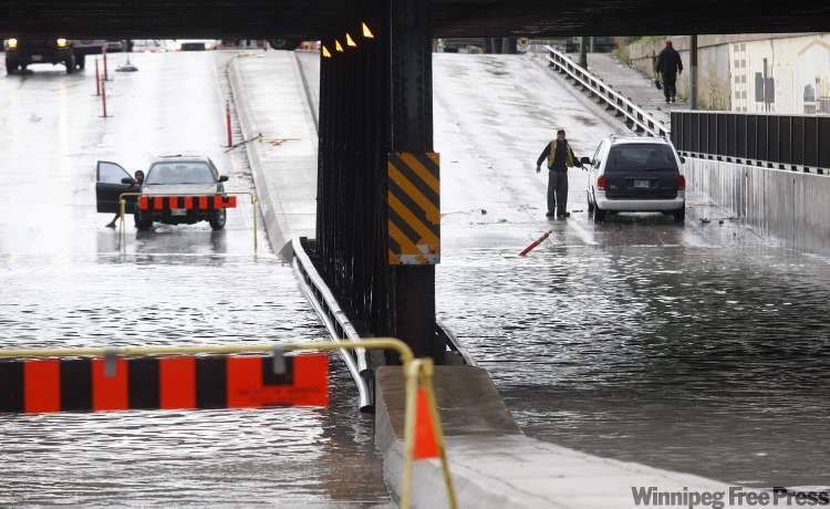 Friday the 13th is not a lucky day for drivers during the morning rush hour as heavy rain hit the city early this morning overwhelming storm sewers, flooding streets and underpasses, including the McPhillips Street underpass.