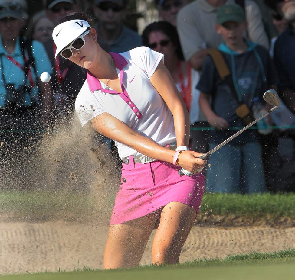 LPGA star Michelle Wie chips one out of the bunker on the 17th and cans it during day one action at St. Charles Country Club in Winnipeg,  Thursday at the CN Canadian Women's Open.