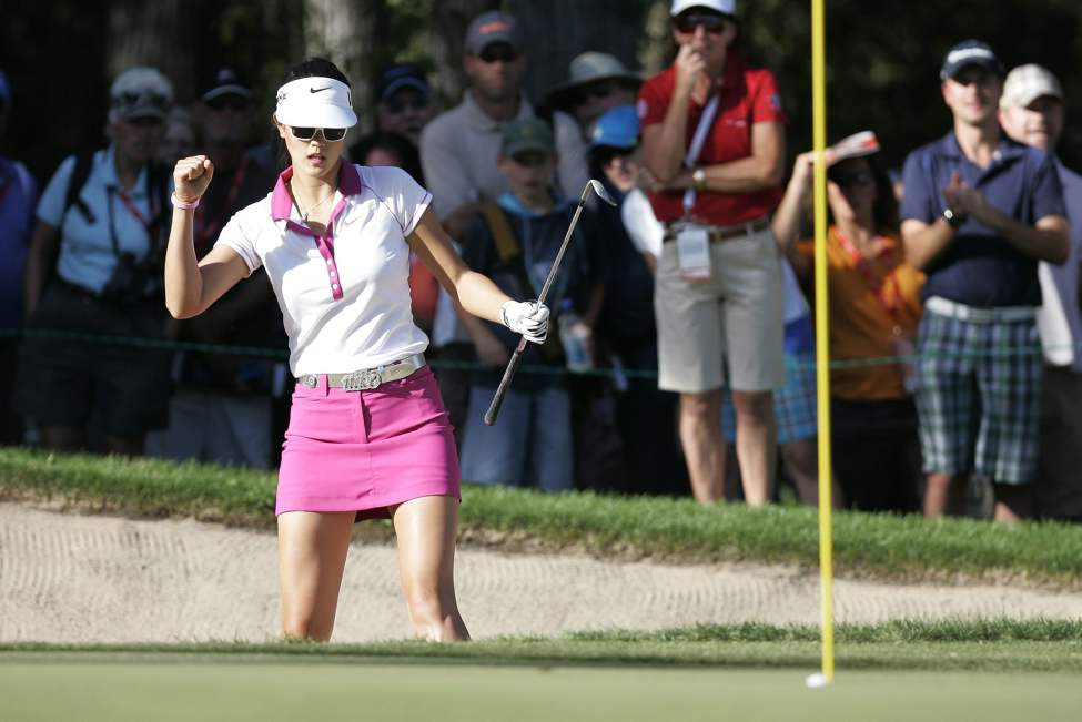 Michelle Wie pumps the air as she sinks her bunker shot on seventeen  for a birdie in the opening round of the CN Canadian Women's Open 2010 in Winnipeg, Thursday, August 26, 2010.