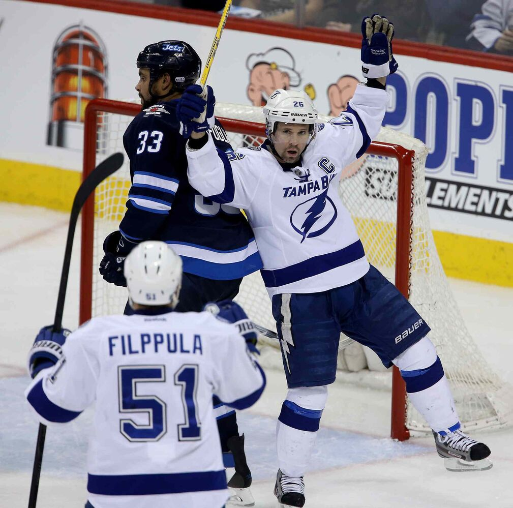 Tampa Bay Lightning's Martin St. Louis (26) celebrates what would be the game-winning goal against the Winnipeg Jets' during the third period. (Trevor Hagan / The Canadian Press)