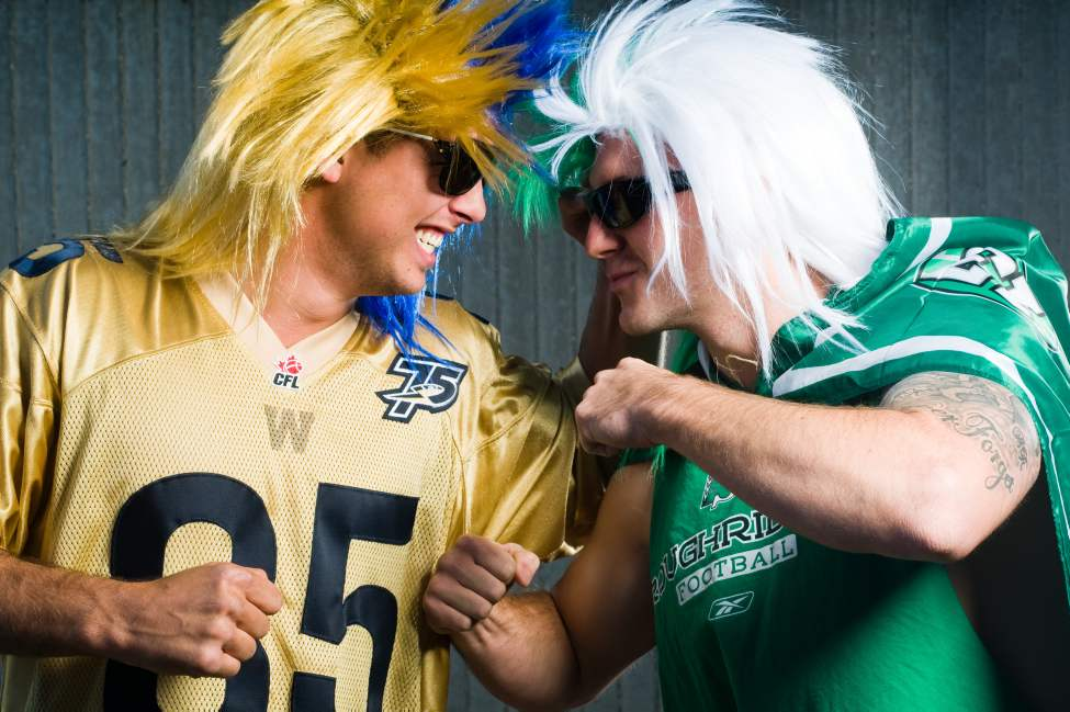 Bomber fan Roman Naumiuk and Rider fan Clint Senko duke it out ... in a friendly way.