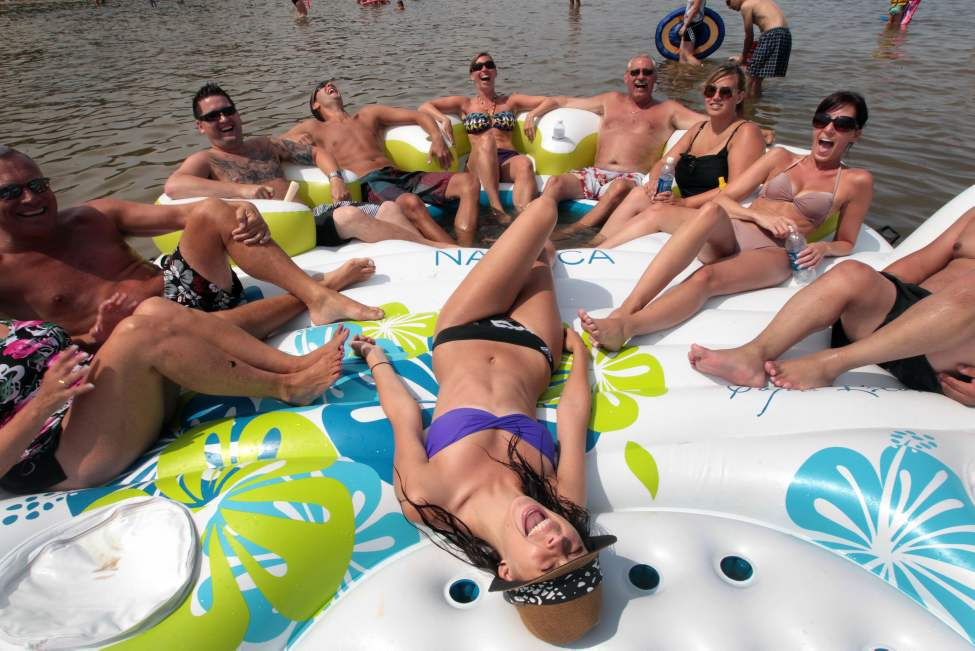 Robyn Gel, foreground, and friends on a huge raft at Grand Beach to enjoying the beautiful weather on the August Long weekend. July 31 2010 (JOE BRYKSA / WINNIPEG FREE PRESS)