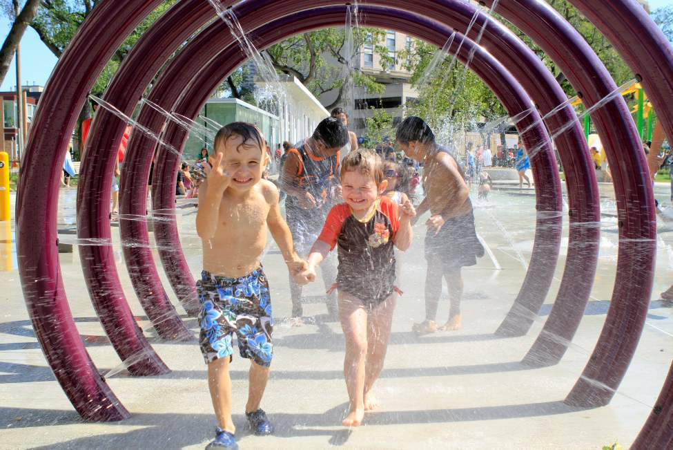 Jesse Hutchinson, 5, and his sister Gracie Bauman, 4, cool off in the new splash park at Central Park. August 26 2010 (JANEK LOWE / WINNIPEG FREE PRESS)