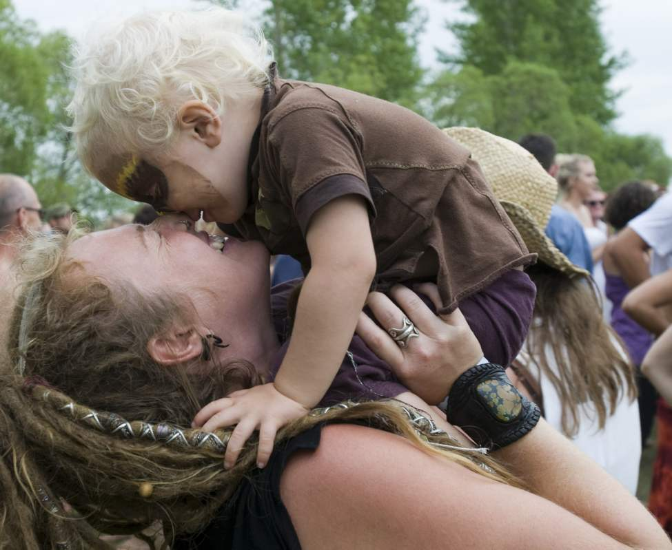 Tusa Kroeker shares a moment with son Kaius (age 2) at the Folk Festival at Birds Hill Park.  July 10 2010 (DAVID LIPNOWSKI / WINNIPEG FREE PRESS)