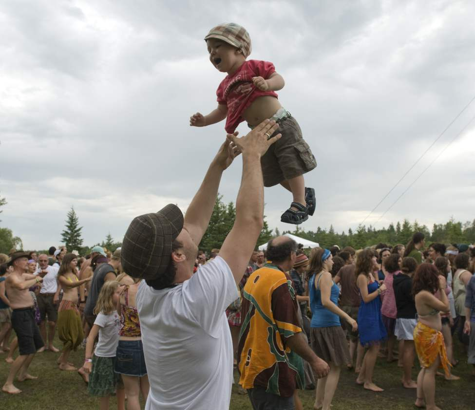 Ezra Reimer tosses his son Leif, 1, at the Folk Festival at Birds Hill Park. July 10 2010 (DAVID LIPNOWSKI / WINNIPEG FREE PRESS)