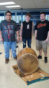 Red Eagle Drum Group meets at Churchill High School every Thursday to sing and socialize. From left: lead singer Freeman White Jr., student George Caribou, and educational assistant Tyler Binguis.