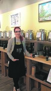 Chantal Hogue, manager of Frescolio Fine Oils and Vinegars, says she's pleased to help those in need by setting up a collection box for Winnipeg Harvest in her store.