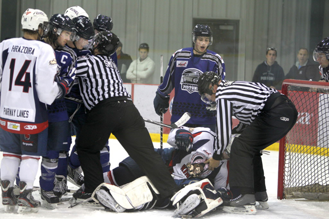 The Steinbach Pistons and the Dauphin Kings scramble in front of the Pistons' net Saturday. The Steinbach Pistons won the game. (Ruth Bonneville/Winnipeg Free Press)