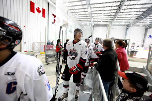 The OCN Blizzard celebrate their win against the Portage Terriers as they leave the ice Saturday. The OCN Blizzard won the game  2 -1 in a shootout.  (Ruth Bonneville / Winnipeg Free Press)