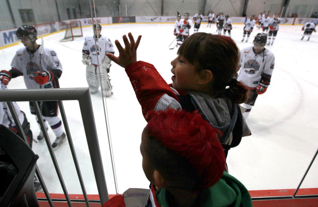 Young fans of the OCN Blizzards wave at the players as they leave the ice after their win against the Portage Terriers during the Old Dutch MJHL Showcase Tournament  at IcePlex Arena Saturday.