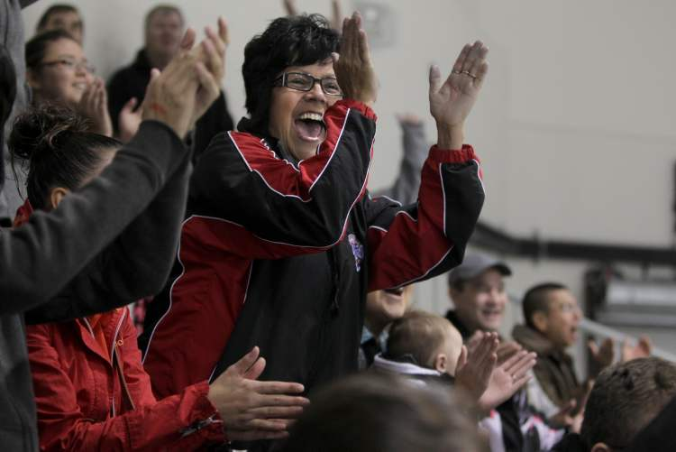Pearl Cochrane celebrates after her son's team - the OCN Blizzards beat the Portage Terriers in a shootout. (Ruth Bonneville/Winnipeg Free Press)