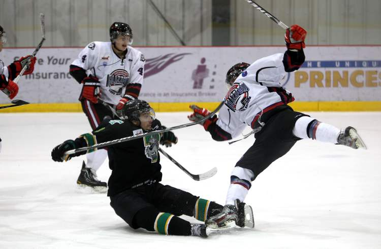 Portage Terriers #3 Tyler Anton collides with OCN Blizzard #19 TJ Constant during third-period action. The OCN Blizzard went on to win the game  2 -1 in a shootout. (Ruth Bonneville/Winnipeg Free Press)