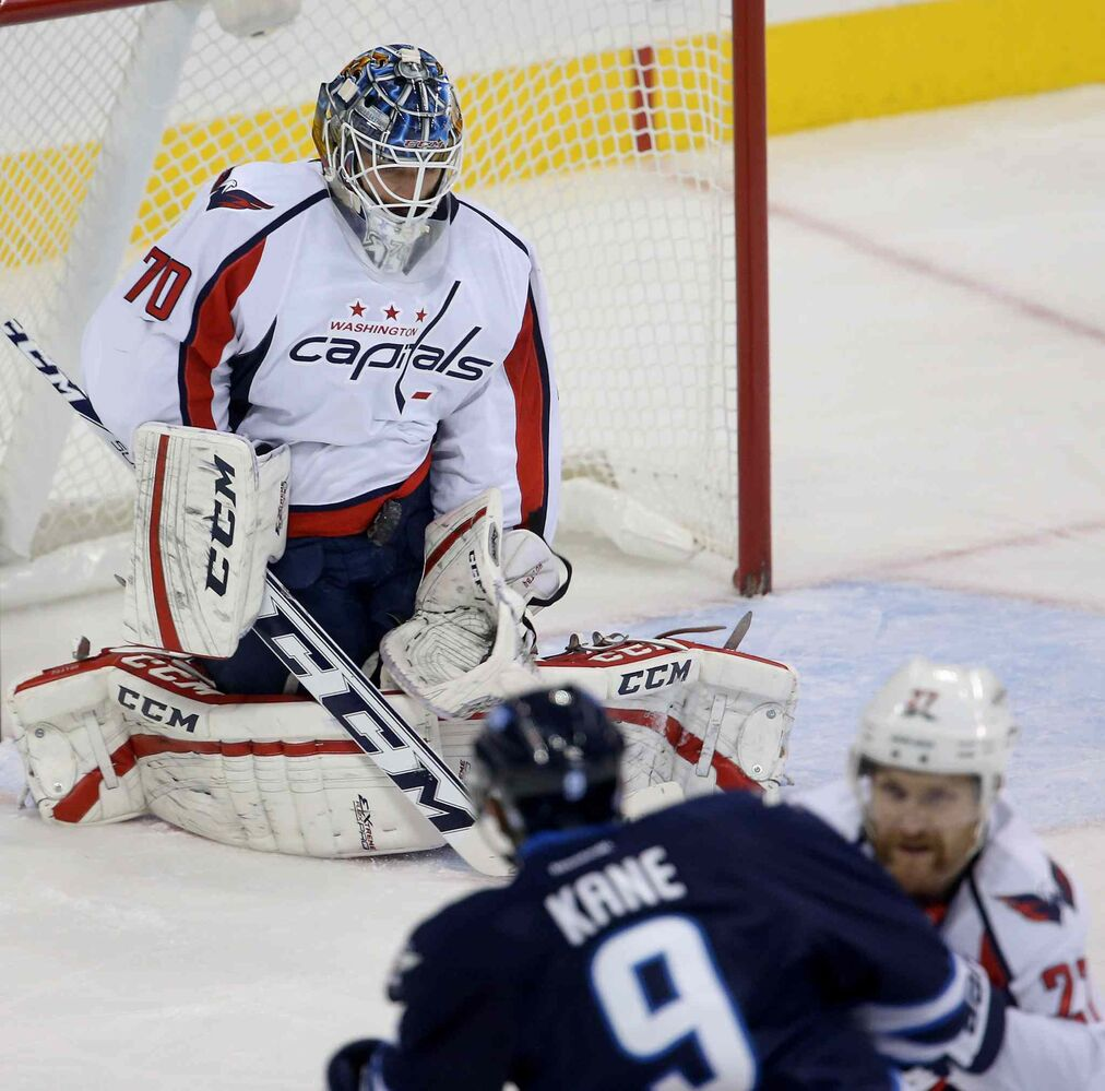 Washington Capitals goaltender Braden Holtby stops a shot by Winnipeg Jets forward Evander Kane in the first period.