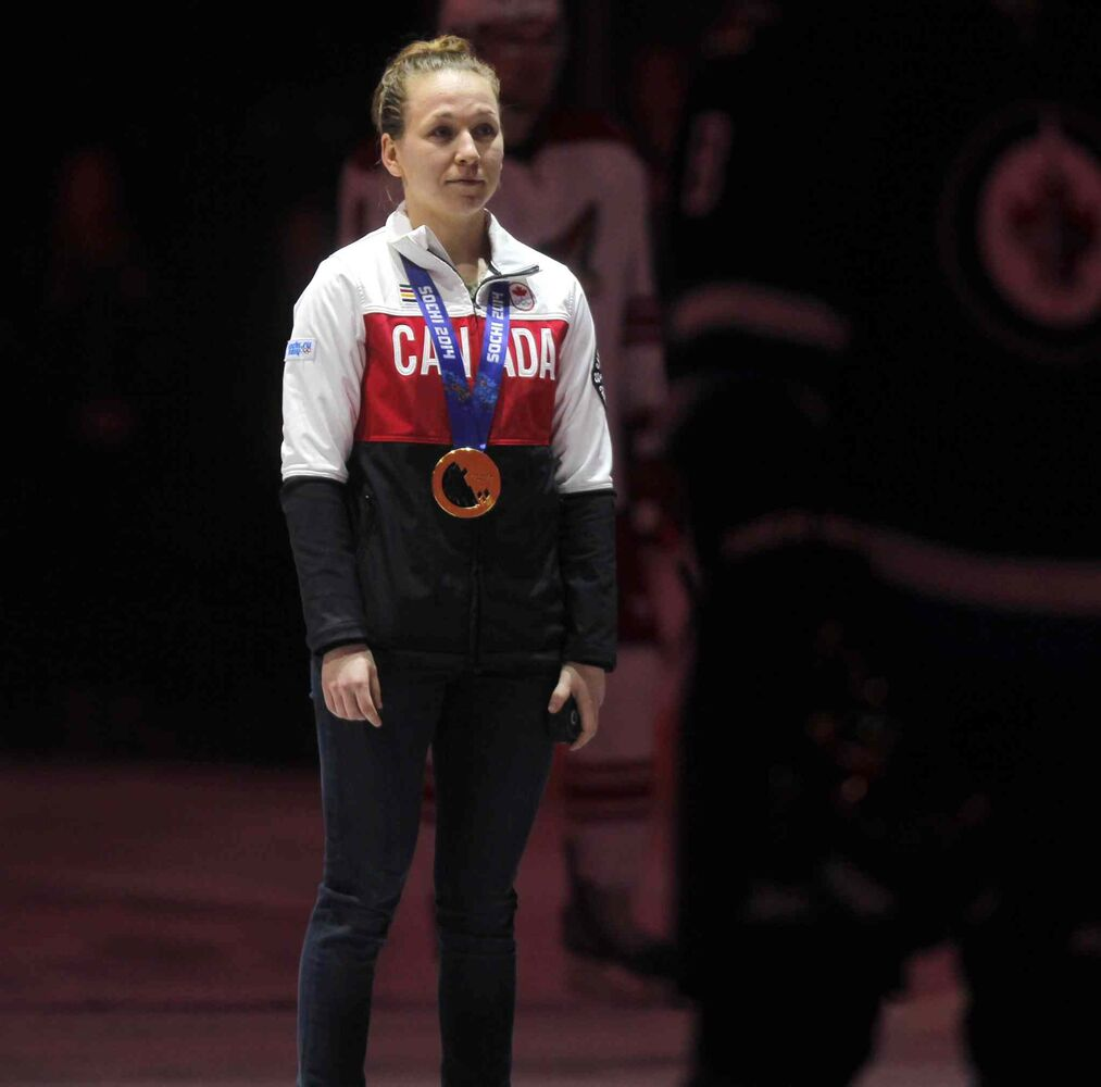 Olympic gold-medal hockey player Jocelyne Larocque, of Ste. Anne, gets ready to drop the puck for the opening of Thursday's Winnipeg Jets game against the Phoenix Coyotes at Winnipeg's MTS Centre.  ( BORIS MINKEVICH / WINNIPEG FREE PRESS)