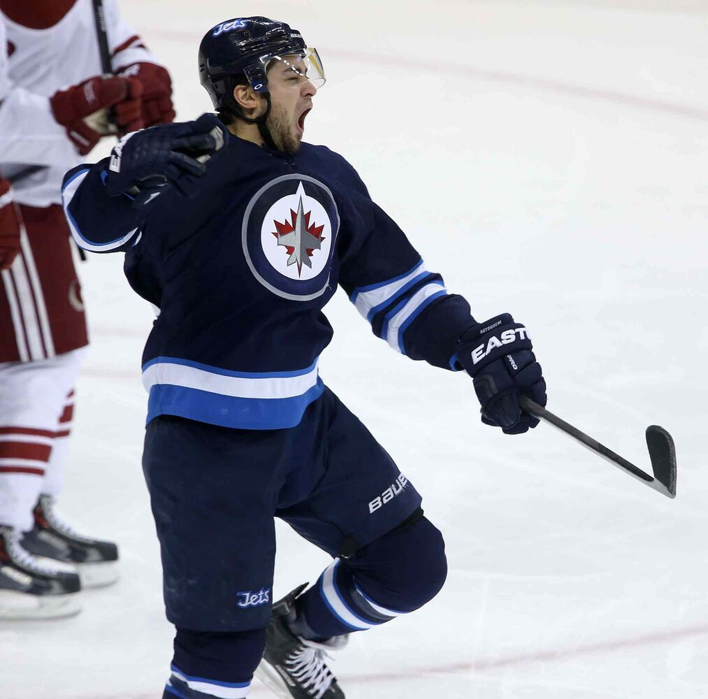 Winnipeg Jets Devin Setoguchi celebrates his third-period goal against the Phoenix Coyotes.