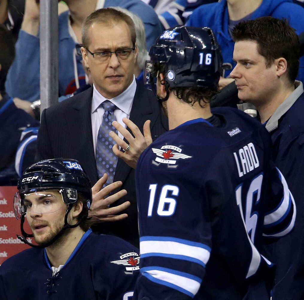 Winnipeg Jets head coach Paul Maurice speaks to captain Andrew Ladd during the second period.
