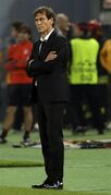 Roma coach Rudi Garcia follows the game of the Group E Champions League soccer match between Roma and Bayern Munich at the Olympic stadium, in Rome, Tuesday, Oct. 21, 2014. (AP Photo/Alessandra Tarantino)