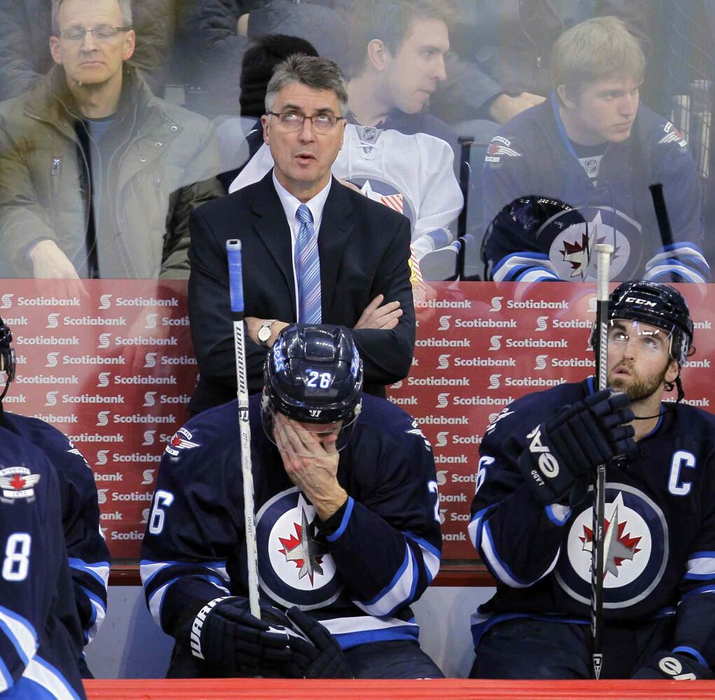 Winnipeg Jets coach Claude Noel looks up at the scoreboard.