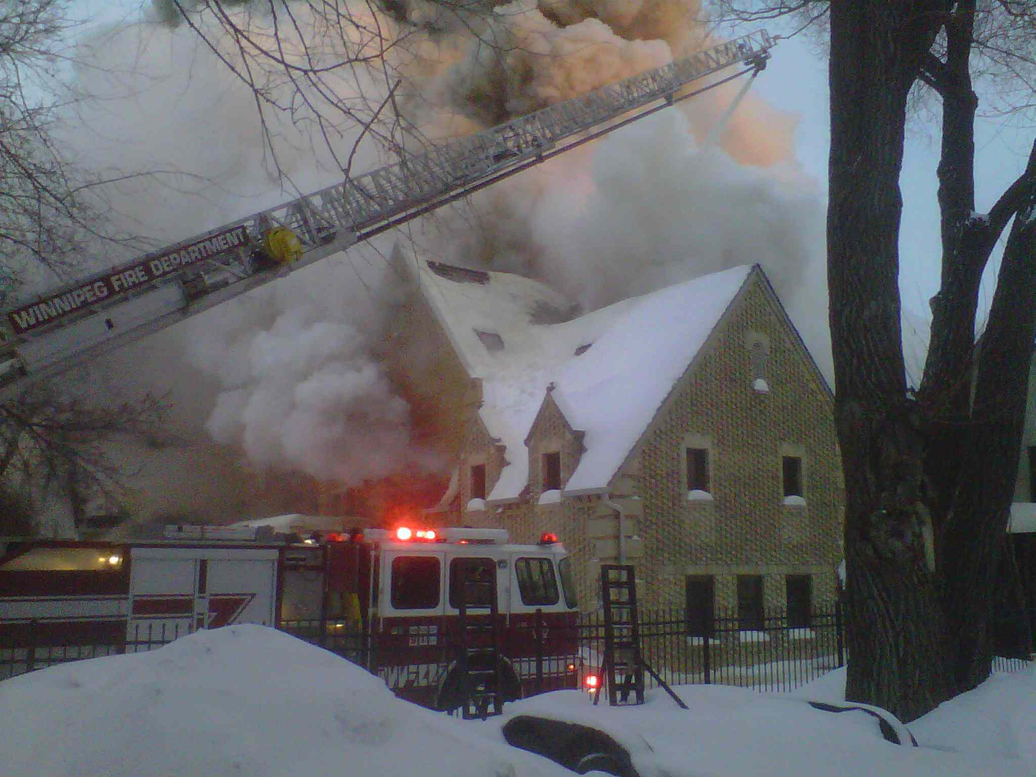 Firefighters battle a blaze at 1021 Wellington Cres. Sunday morning.