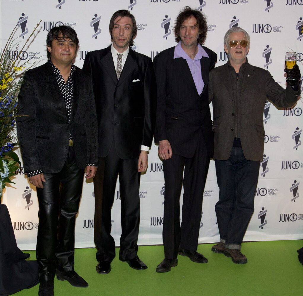 Three members of the Sadies arrive on the green carpet, while Greg Keelor of Blue Rodeo arrives with beer in hand, ready to have a good time at the Juno Gala. (JOHN WOODS / THE CANADIAN PRESS)