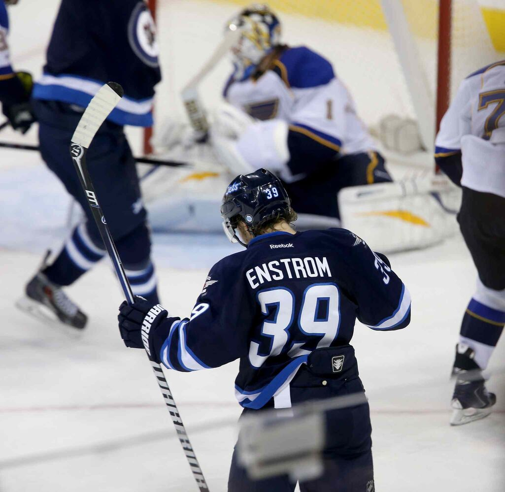 Winnipeg Jets' Toby Enstrom celebrates his game-tying goal on St. Louis Blues goaltender Brian Elliott during third-period action. (TREVOR HAGAN / WINNIPEG FREE PRESS)