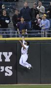 Chicago White Sox center fielder Adam Eaton catches a fly ball hit by Boston Red Sox's David Ortiz during the first inning of a baseball game in Chicago, Thursday, April 17, 2014. (AP Photo/Paul Beaty)