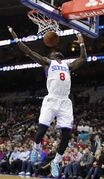 Philadelphia 76ers' Tony Wroten reacts to his breakaway dunk during the first half of an NBA basketball game against the Brooklyn Nets, Wednesday, Nov. 26, 2014, in Philadelphia. (AP Photo/Chris Szagola)
