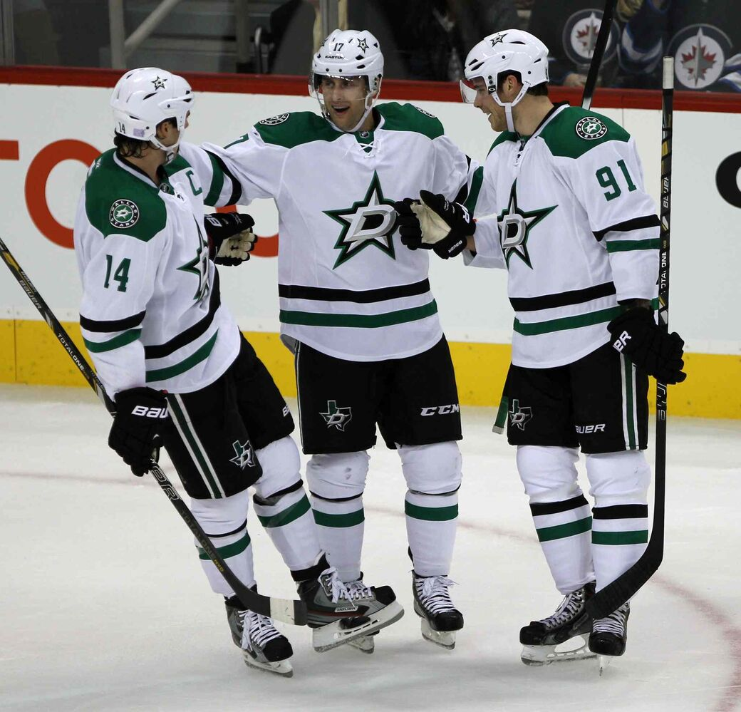 From left: Jamie Benn, Rich Peverley and Tyler Seguin celebrate Seguin's first-period goal. (JOE BRYKSA / WINNIPEG FREE PRESS)