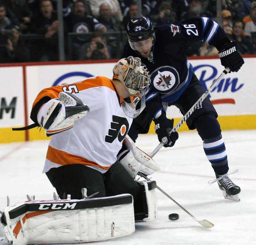 Winnipeg Jets forward Blake Wheeler parks himself in front of Philadelphia Flyers goaltender Chris Mason during the second period. (JOE BRYKSA / WINNIPEG FREE PRESS)