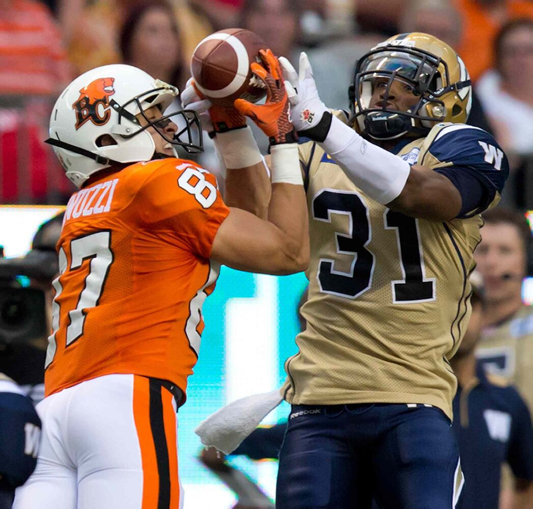 Winnipeg Blue Bombers' Maurice Leggett, right, prevents B.C. Lions' Marco Iannuzzi from making the receptionn during the first half of Friday's game. (DARRYL DYCK / THE CANADIAN PRESS)