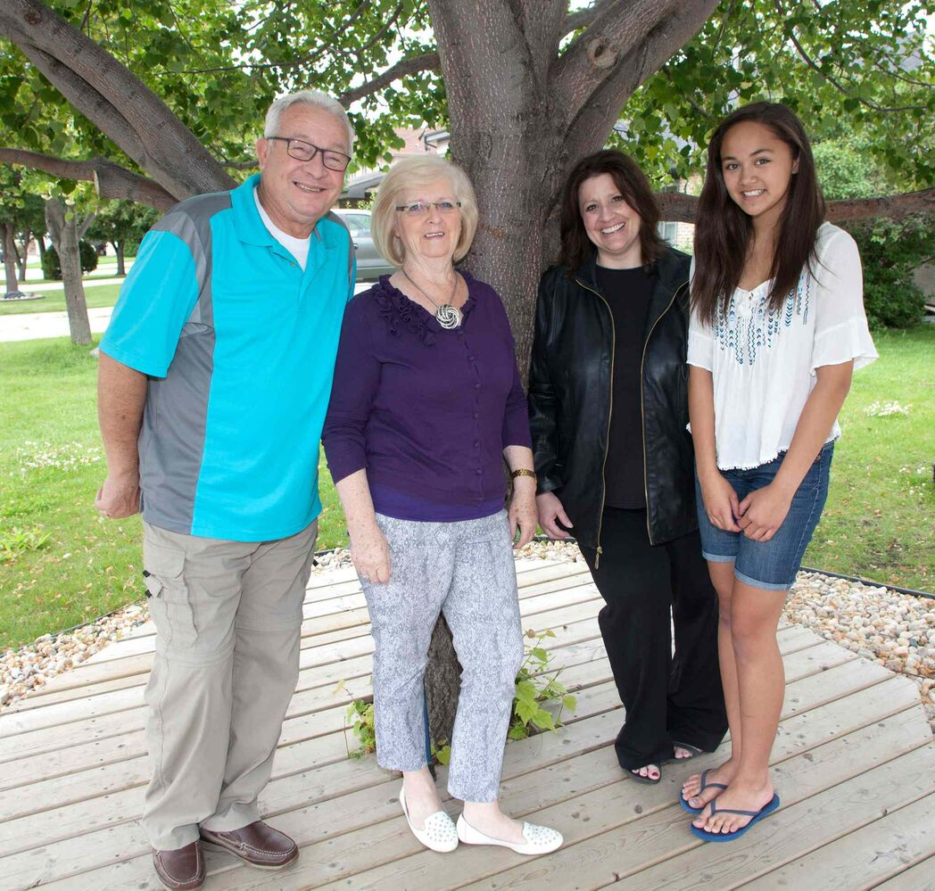 The 10th annual Latter-day Saints Summer Food Drive kicks off Saturday, June 18, 2015. Volunteers will be dropping off a flyer listing Winnipeg Harvest's 10 most-needed items during the lean summer months. Pictured, from left, are Jeff Hadfield, Maggie Hadfield, Charlene Laluk (special events co-ordinator, Church of Latter-day Saints) and Victoria DeGuzman.  (John Johnston / Winnipeg Free Press)