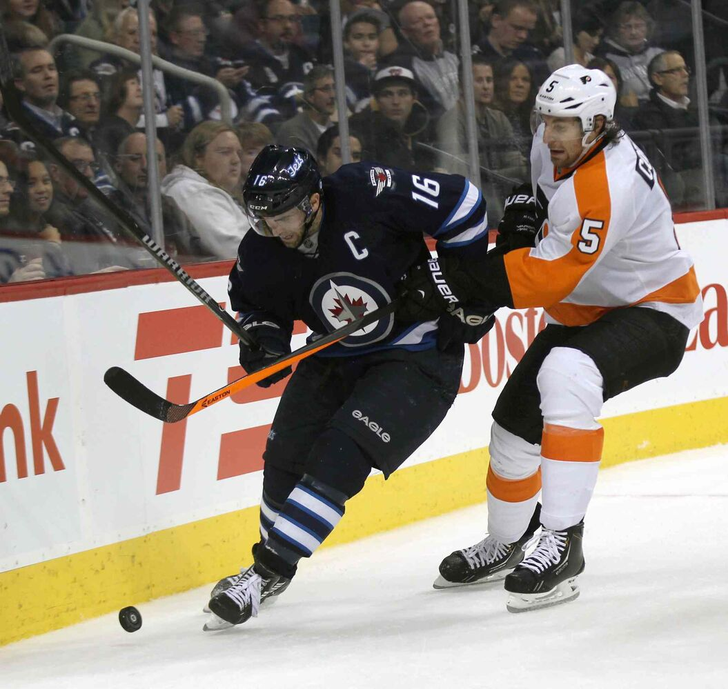 Winnipeg Jets captain Andrew Ladd ties it up with Philadelphia Flyers defenceman Braydon Coburn during the second period.