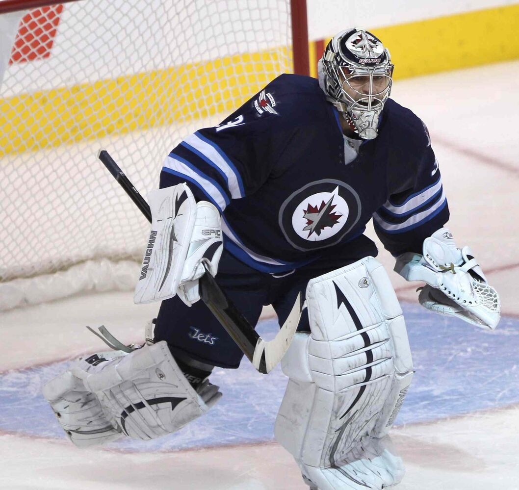 Winnipeg Jets goaltender Ondrej Pavelec reacts after his team won 3-2 in a shootout over the Philadelphia Flyers Friday night. (JOE BRYKSA / WINNIPEG FREE PRESS)