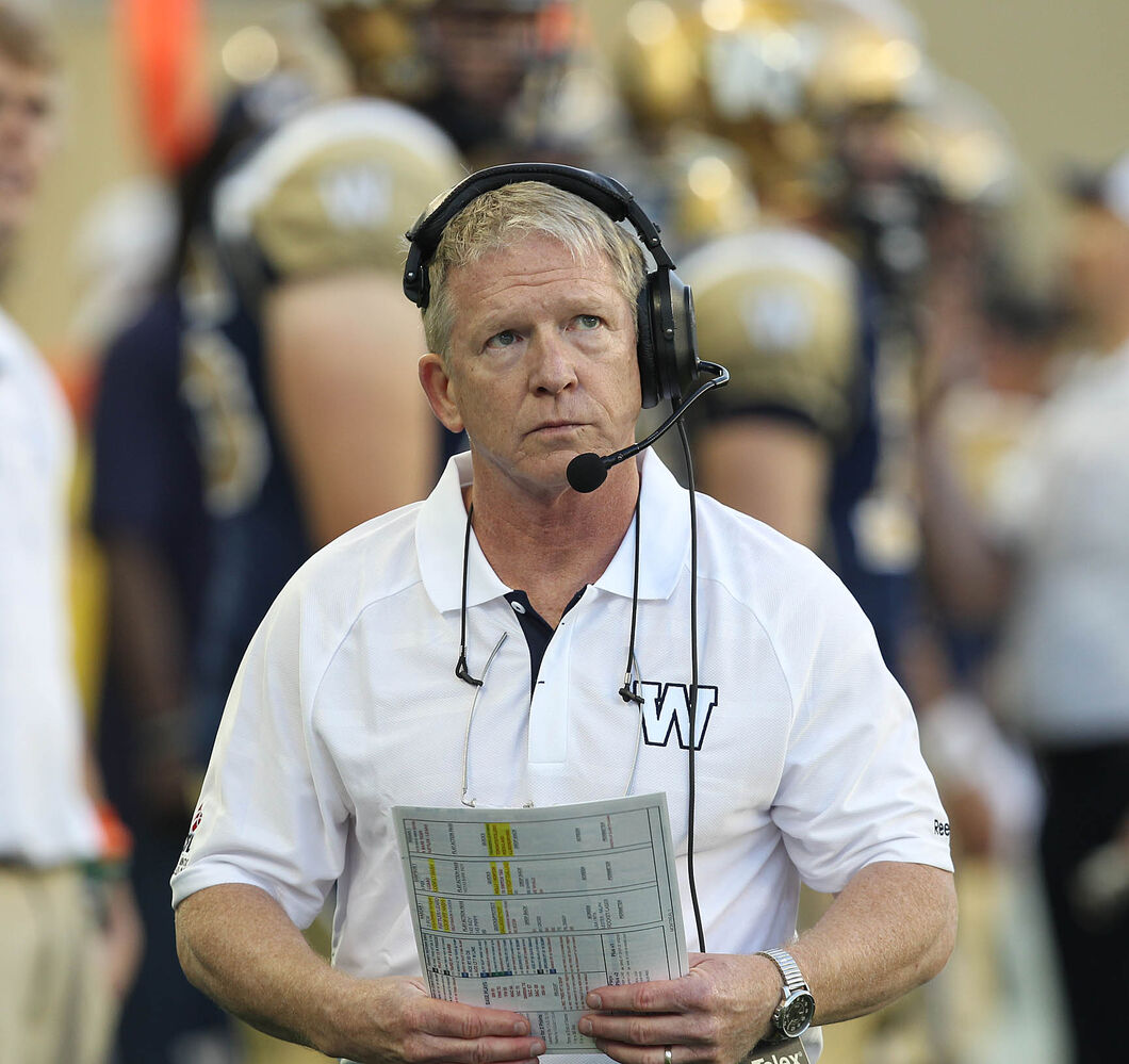 Winnipeg Blue Bombers head coach Tim Burke scopes out the action during second-quarter action. (JOE BRYKSA / WINNIPEG FREE PRESS)