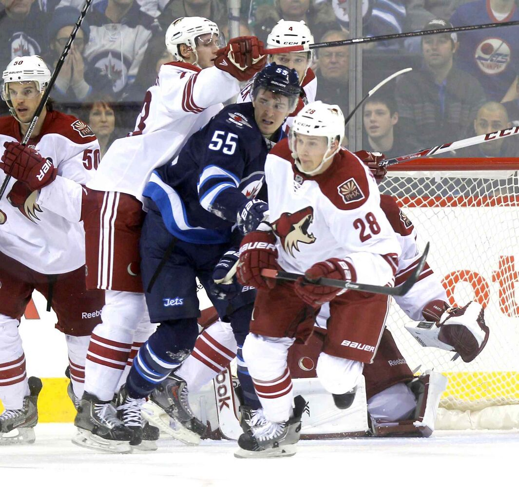 Winnipeg Jets' Mark Scheifele gets ambushed by a pack of Phoenix Coyotes during Thursday's home game at the MTS Centre.  (BORIS MINKEVICH / WINNIPEG FREE PRESS)