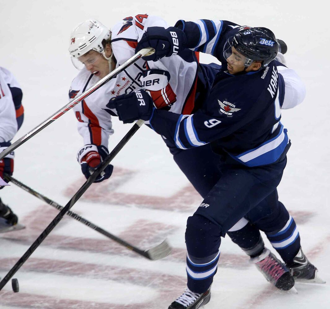 Winnipeg Jets forward Evander Kane mixes it up with Washington Capitals' John Carlson.