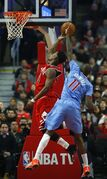 Chicago Bulls guard Jimmy Butler (21) has his shot blocked by Los Angeles Clippers guard Jamal Crawford (11) during the first half of an NBA basketball game in Chicago, on Sunday, March 1, 2015. (AP Photo/Jeff Haynes)