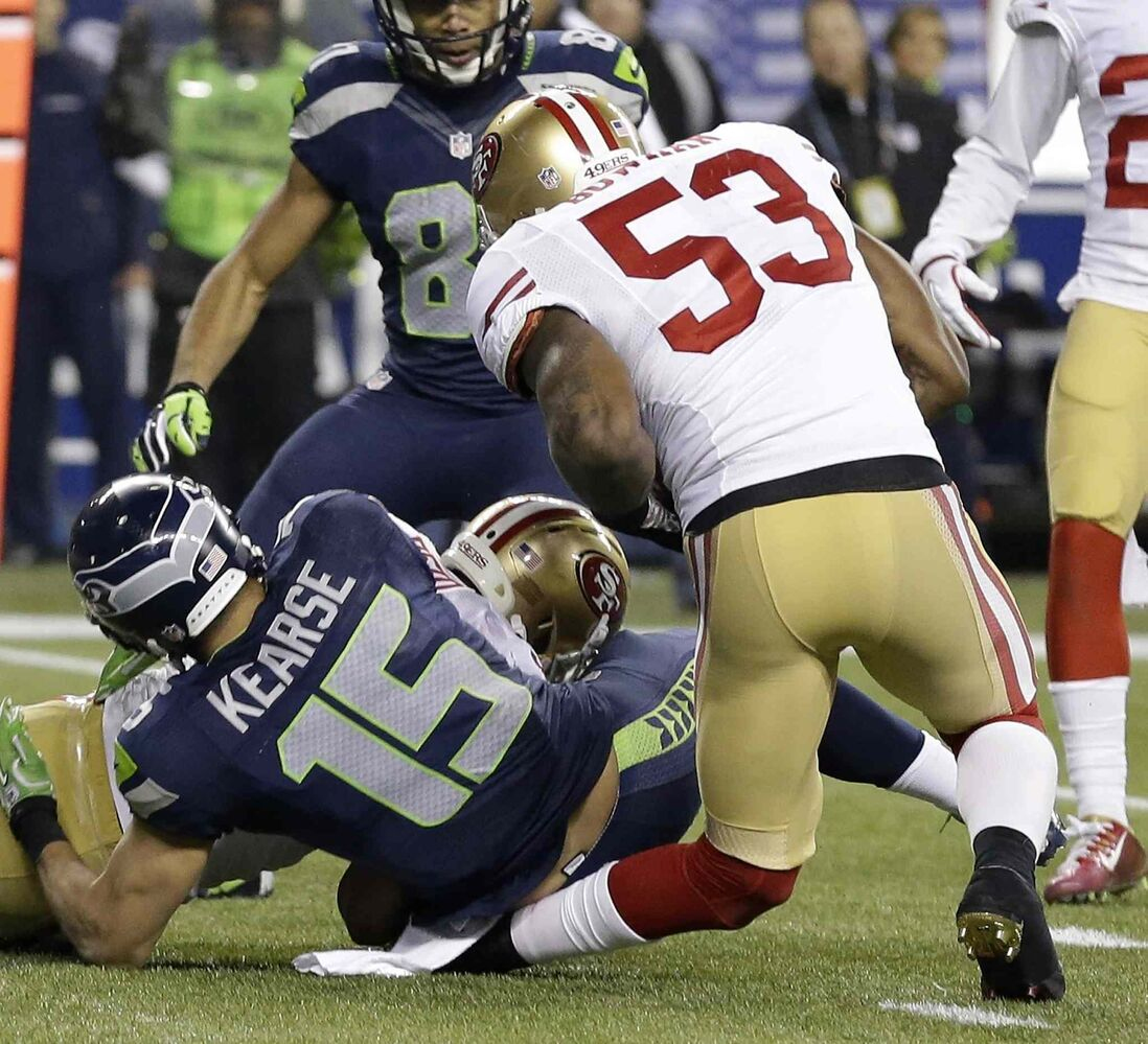 San Francisco 49ers' NaVorro Bowman injures his leg during the second half of the NFL football NFC Championship game. (Elaine Thompson / The Associated Press)