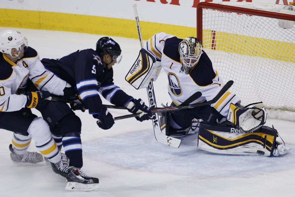 Buffalo Sabres' goaltender Jhonas Enroth (#1) gets a toe on Winnipeg Jets' Evander Kane's (#9) breakaway shot during the third period in Winnipeg Tuesday.  (John Woods / Winnipeg Free Press)