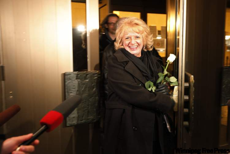 Candace Derksen's mother, Wilma Derksen, emerges from the Law Courts Building after Friday's guilty verdict, carrying a white rose she planned to lay at her daughter's grave at a private family service this morning.