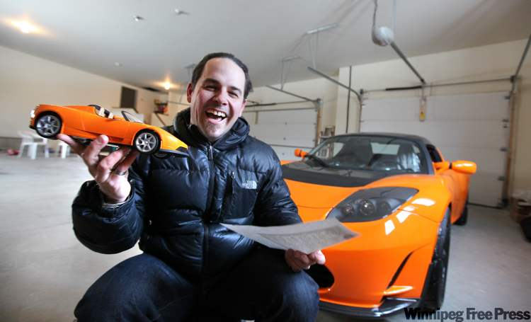 Keith Bilous celebrates his 39th birthday Tuesday by taking delivery of the province's first production electric car, a $200,000 Tesla Roadster.