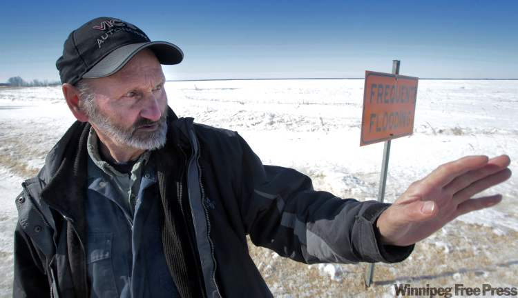 Inwood farmer John Dyck says the road that goes by his farmstead has washed out every spring for the last few years. This is due to flooding of the nearby Shoal Lakes.