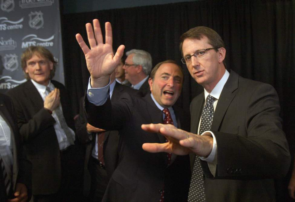 Mark Chipman of True North Sports and Entertainment LTD , right, with  NHL commissioner Gary Bettman, center, and David Thomson after the announcement of the  NHL is returning to Winnipeg. May 31, 2011 (JOE BRYKSA/WINNIPEG FREE PRESS)
