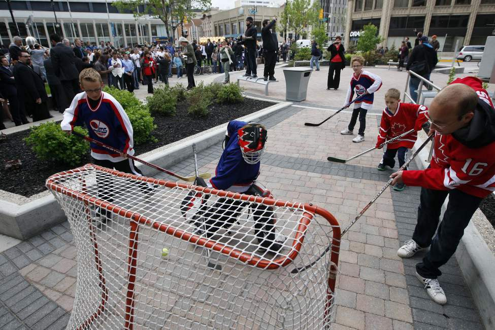 NHL comes back to Winnipeg - kids from a St. James club brought their net and sticks to near Portage and Main just before the announcement was made. (KEN GIGLIOTTI / WINNIPEG FREE PRESS)