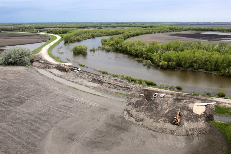 Work continues at the Hoop and Holler bend to repair the cut that was made to reduce the pressure on the dikes protecting rural communities from the Assiniboine River.