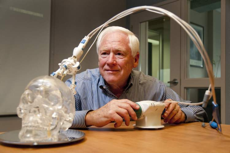 Jim Duncan of Monteris Medical, Inc., with a device demonstrating the Winnipeg company's technology of targeting deep-seated brain tumours with a laser.