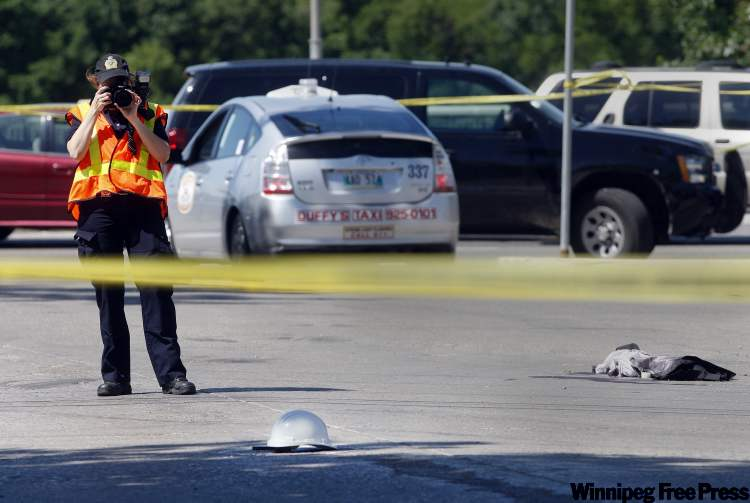 An officer collects evidence following a police-involved shooting at St. Mary's Road and Essex Avenue.