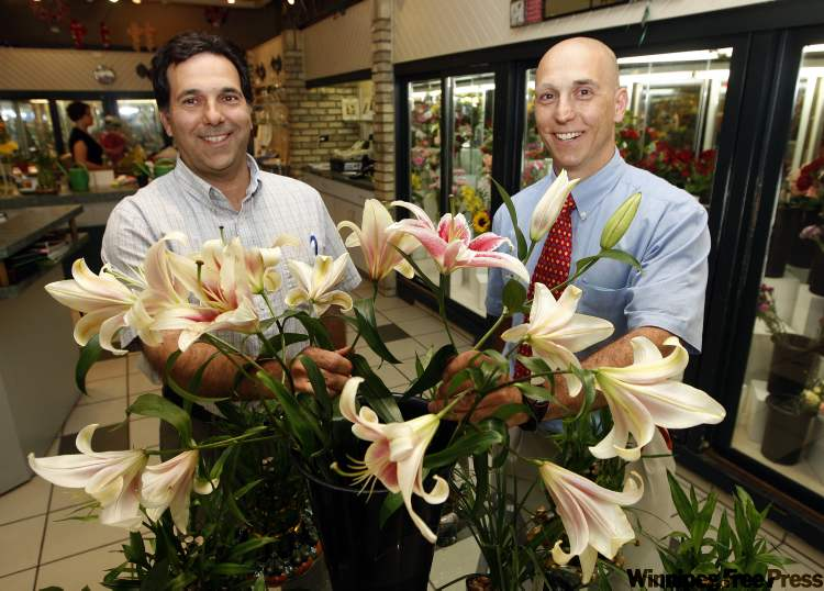 Ernie Cholakis and his brother, Costa (right), were offered a much smaller space in the mall.