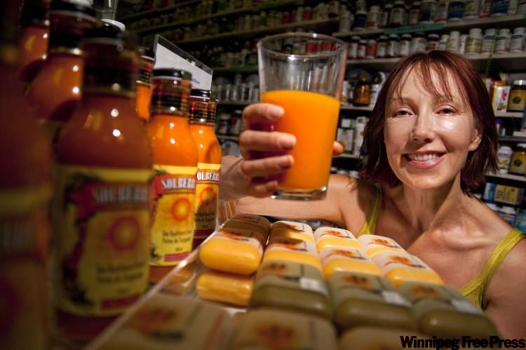 Mila Maximets displays her Solberry sea buckthorn puree, which hit health-food stores last week. It's the first such product in Manitoba.