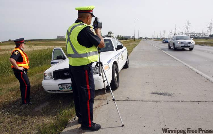 Winnipeg Police Service Sgt. Mark Hodgson (left) and Sgt. Lou Malo monitor vehicles' speeds on Bishop Grandin Boulevard, where drivers were clocked going at least 50 kilometres per hour over the 80 km/h limit.